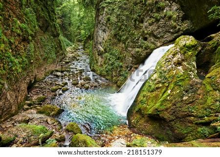 Waterfall in Galbenei gorge, Apuseni national park, Romania - stock photo