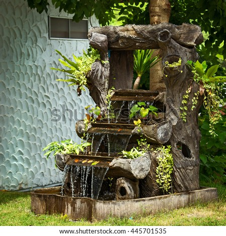 Waterfall in garden. - stock photo
