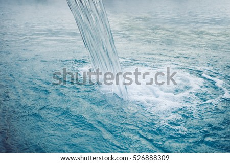 waterfall in hot thermal pool closeup