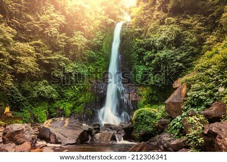 Waterfall in Indonesian jungle - stock photo