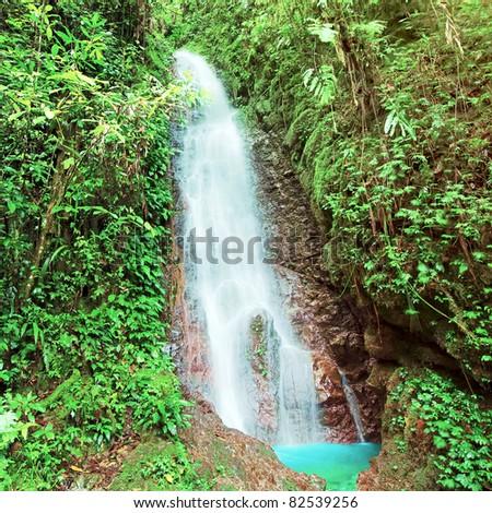 Waterfall in Kinabalu park at sunny day. Malaysia - stock photo
