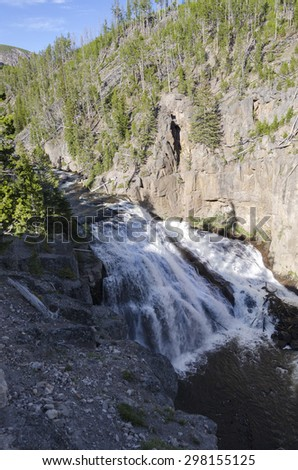 waterfall in Madison River in Yellowstone National Park - stock photo