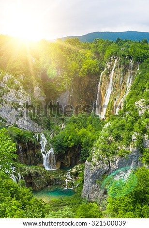 waterfall in mountain forest - stock photo