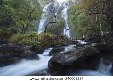 waterfall in national park, deep forest - stock photo