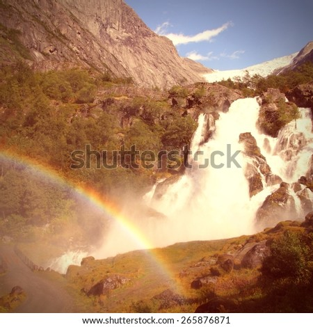 Waterfall in Norway, Jostedalsbreen National Park. Vintage style photo color. - stock photo