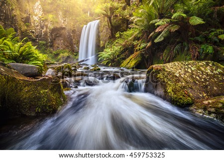 Waterfall in rain forest after heavy rain. - stock photo
