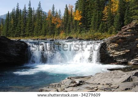 Waterfall in sheep river valley, alberta, canada - stock photo