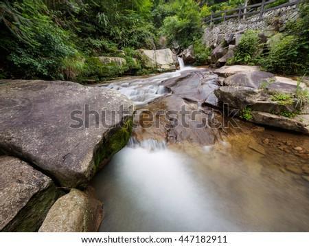 Waterfall in slow shutter speed - stock photo