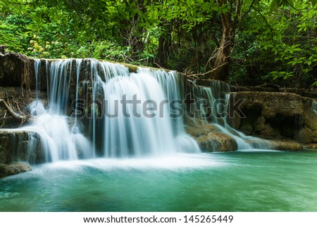waterfall in thai national park. In the deep forest on mountain - stock photo