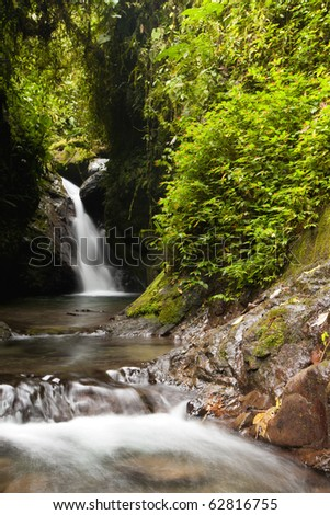 waterfall in the amazonian rain forest - stock photo
