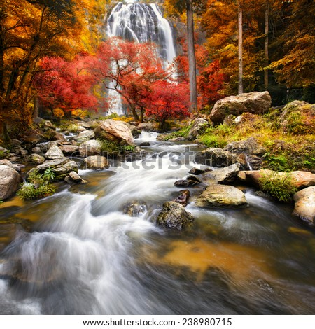 Waterfall in the autumn - stock photo
