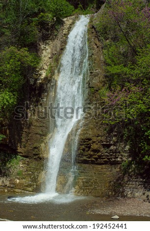 Waterfall in the forest after raining day - stock photo