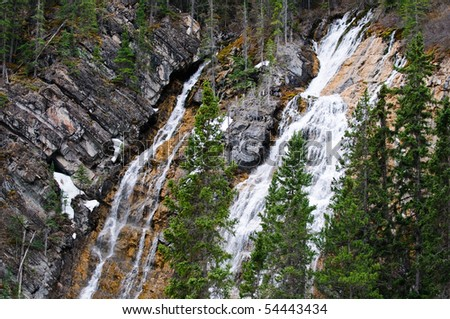 Waterfall in the forest at Grassi Lakes, Canmore Alberta - stock photo