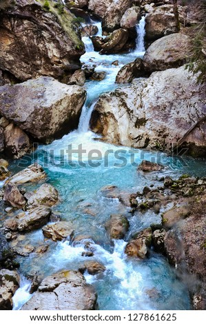 Waterfall in the forest, blue lake - stock photo