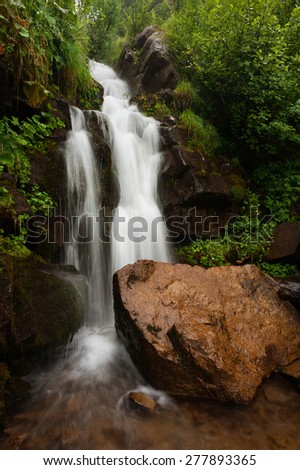 Waterfall in the forest, Carpathian mountains, Ukraine - stock photo