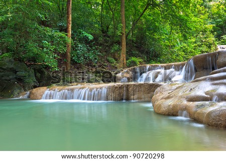 Waterfall in the forrest - stock photo