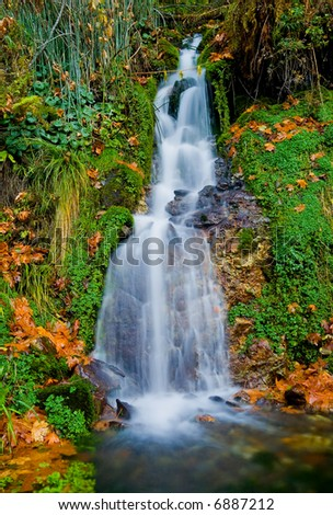 Waterfall in the mountains in Northern California - stock photo