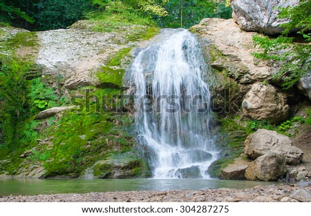 Waterfall in the mountains of the North Caucasus. - stock photo