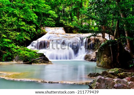 Waterfall in the rain forest, Thailand. - stock photo