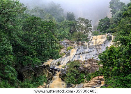 Waterfall in the rocky hill of Sri Lanka on a cloudy day - stock photo