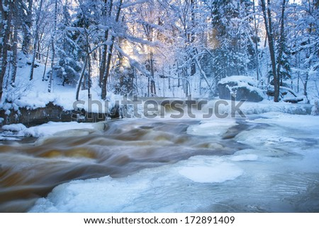 Waterfall in the winter - stock photo