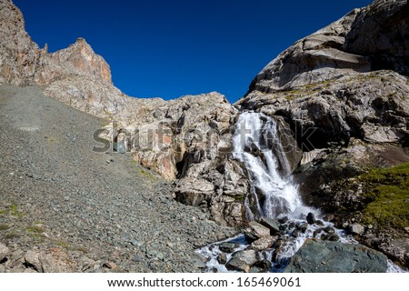 Waterfall in Tien Shan mountains. Kirghizia