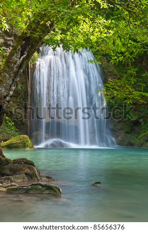waterfall in tropical forest at Eravan national park Kanchanaburi province Thailand - stock photo