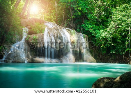 Waterfall in tropical forest at Erawan waterfall National Park, Thailand
