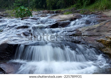 Waterfall in tropical forest at Kra Chong national park, Trang province, Thailand. - stock photo