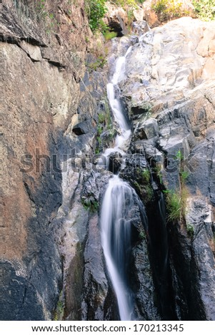 Waterfall in tropical forest, Thailand - stock photo