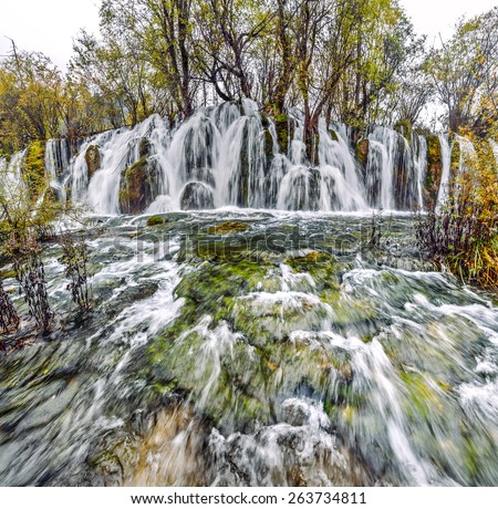 Waterfall. Jiuzhaigou Valley was recognize by UNESCO as a World Heritage Site and a World Biosphere Reserve - China - stock photo