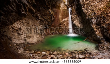 Waterfall Kozjak in autumn time. A magnificent waterfall in the Julian Alps - stock photo