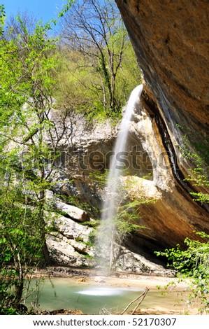 waterfall Kozyrok in Crimea in spring time - stock photo