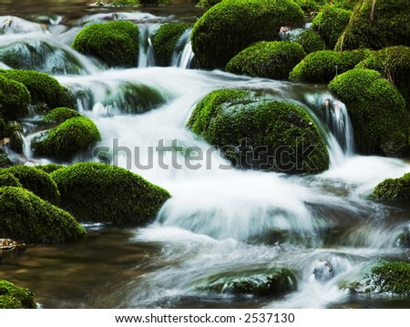 Waterfall movement on the stone background - stock photo