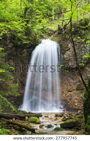 Waterfall near Aschau im Chiemgau with fresh green leaves, Aschau, Bavaria, Germany - stock photo