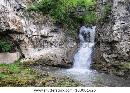 Waterfall near the Dryanovo monastery and the Bacho Kiro cave in Bulgaria - stock photo