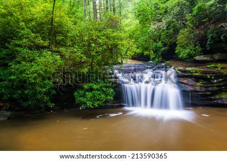Waterfall on Carrick Creek, at Table Rock State Park, South Carolina. - stock photo