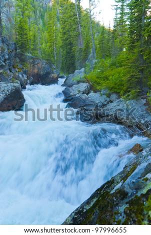 Waterfall on Cascade Creek in Grand Teton National - stock photo