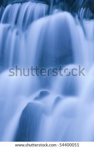 waterfall on mountain river - stock photo