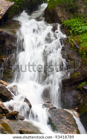 waterfall on mountain river. Carpathian, Ukraine.