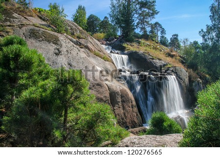 Waterfall on sunny summer day
