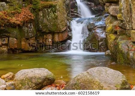 waterfall on the mountain stream with autumn