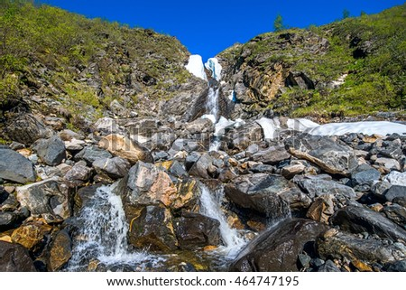 waterfall on the right tributary of the river Ekhe-Ger, Siberia