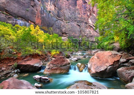 Waterfall on the Virgin River flows through large boulders in Zion Canyon - stock photo