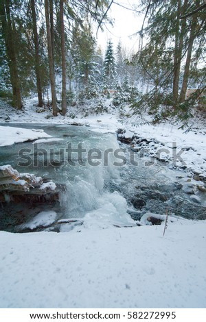 waterfall on the winter river