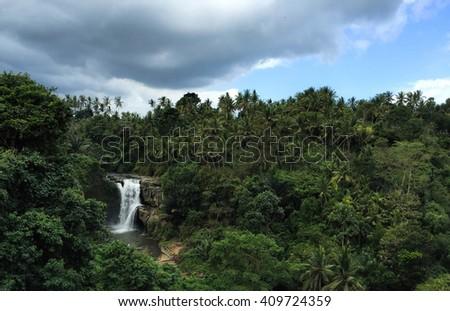 Waterfall Tenenungan, Bali island, Indonesia, waterfall in Bali, waterfall landscape, Bali island tropical nature, waterfall panorama in tropical island, white water in the jungle, waterfall picture - stock photo