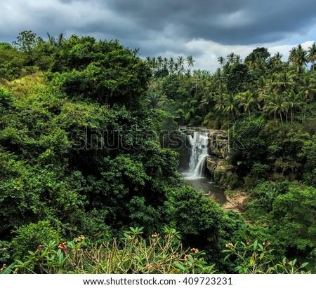 Waterfall Tenenungan in Bali island, travel photography of Bali, waterfall panorama, tropical nature landscape with waterfall, Tenenungan waterfall, waterfall view, waterfall in tropics, Indonesia - stock photo