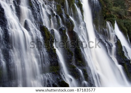 Waterfall: The majestic Burney Falls in northern California's Cascade Range near Mount Shasta. - stock photo