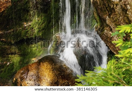 Waterfall with boulders in forest , Czech republic, Jizera mountains, Jedlova waterfall - stock photo
