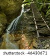 Waterfall with ladder in canyon. Mountain stream in Mountain Slovak Paradise. Slovakia - stock photo